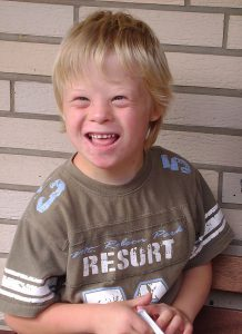 Smiling boy with Down syndrome