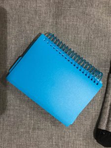 Blue, spiral-bound booklet of 100 index cards