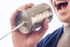 a tin can telephone with a string